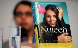 'Nujeen – One Girls's incredible Journey from War-torn Syria in a Wheelchair,' the memoirs of the Syrian national Nujeen Mustafa, on display at the Frankfurt Book Fair in Frankfurt am Main, Germany, Thursday.