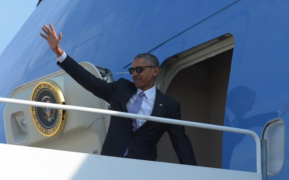 US President Barack Obama waves before boarding Air Force One at Andrews Air Force Base in Maryland on Thursday. Obama is expected in Athens next month.