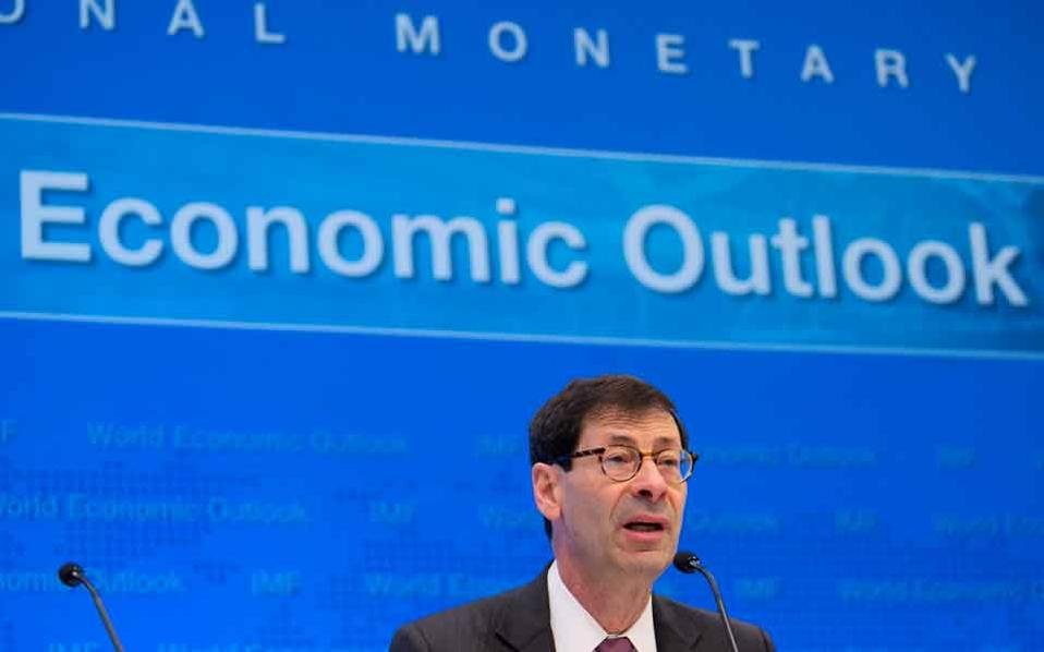 IMF economic counselor and Research Department director Maurice Obstfeld responds to a question during the World Economic Outlook press conference at the IMF Headquarters in Washington on Tuesday.