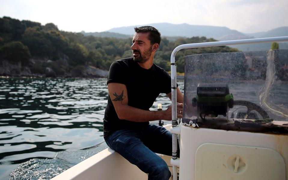 Greek fisherman Stratis Valamios, 40, a Nobel Peace Prize nominee, is seen onboard his motorboat at the sea, near the Skala Sikamias village on the island of Lesvos.
