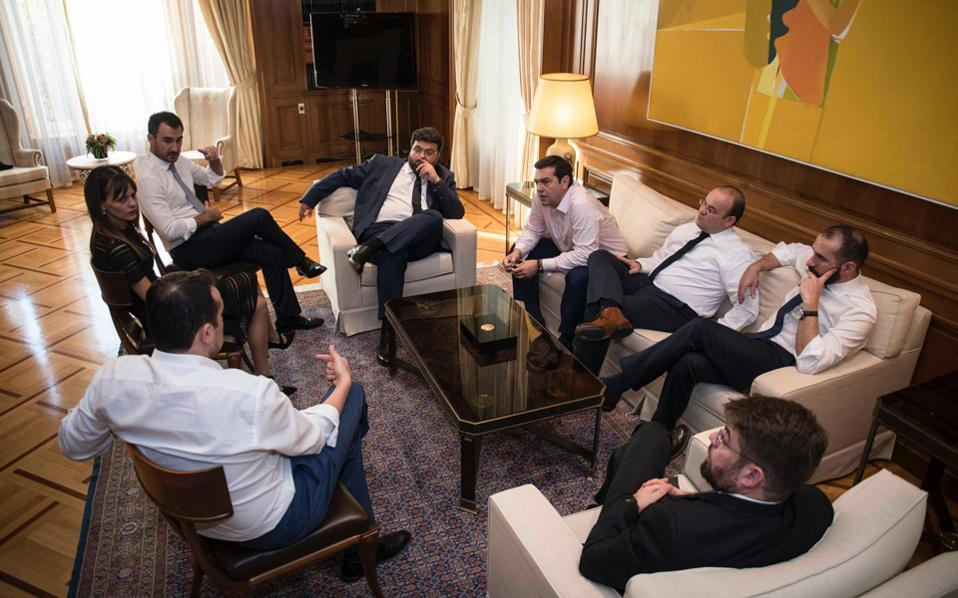 Effie Achtsioglou sits with other young cabinet entrants in a briefing with Prime Minister Alexis Tsipras that followed the reshuffle