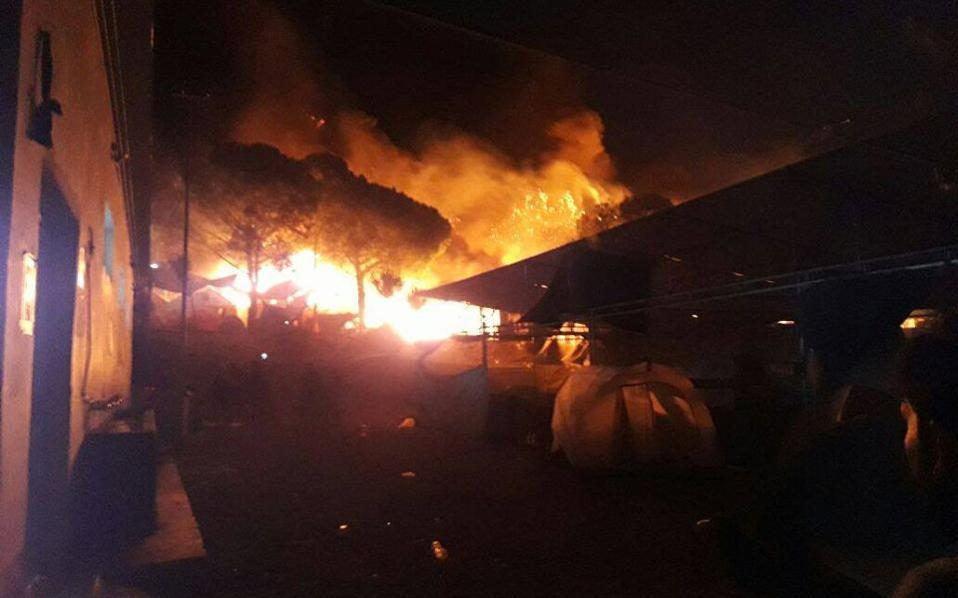 Refugees set Greek migrant camp on fire, loot nearby stores