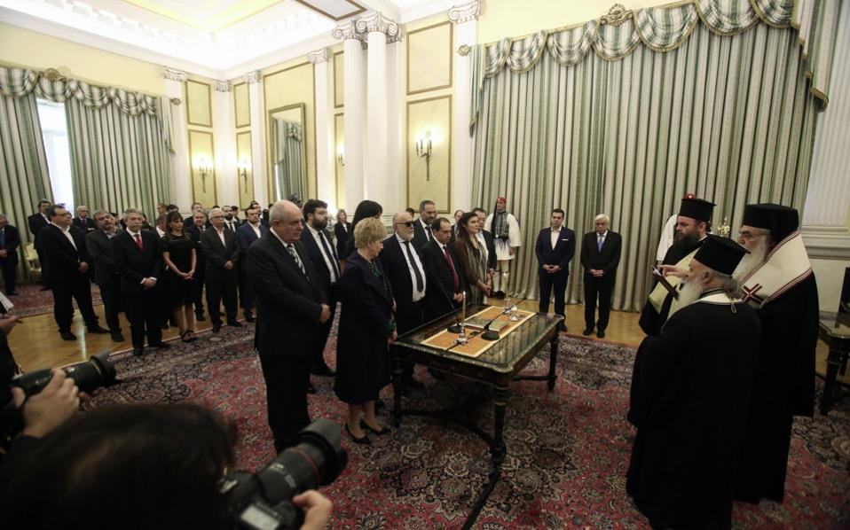 Prime Minister Alexis Tsipras and President Prokopis Pavlopoulos oversee the swearing in of the new cabinet on Saturday.