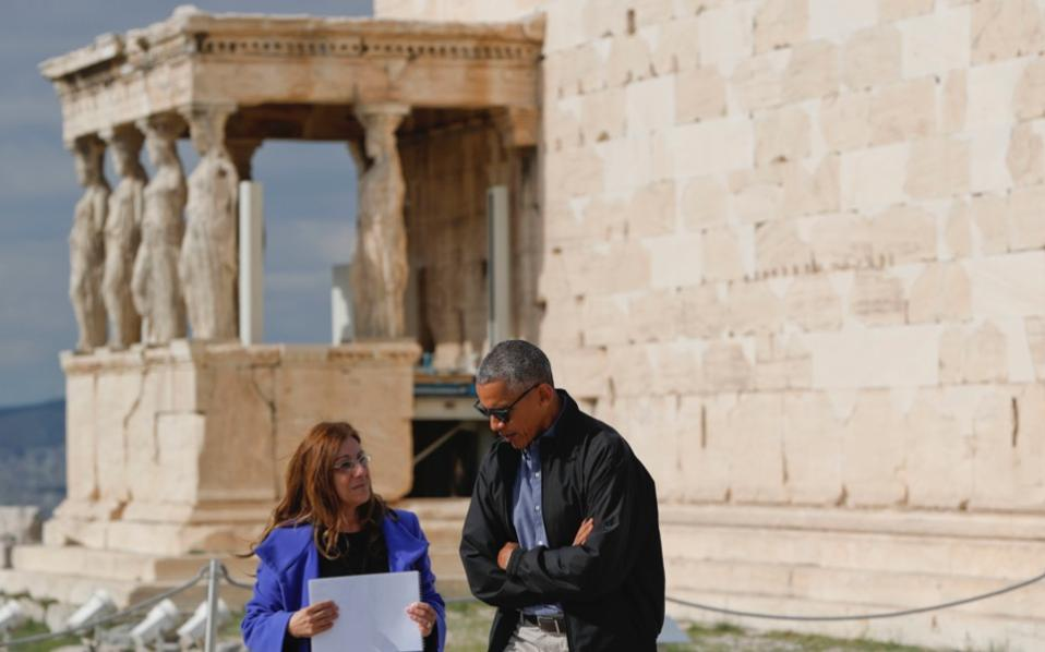 US President Barack Obama tours Acropolis with Dr Eleni Banou, director of Ephorate of Antiquities for Athens of the Ministry of Culture, in Athens, on Wednesday.