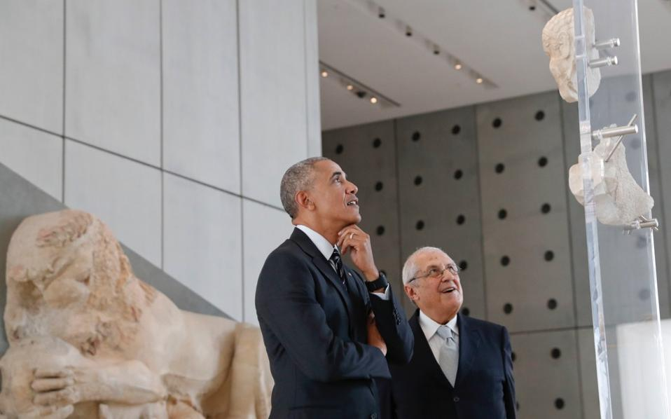 The outgoing US president is shown around the Acropolis Museum by its director, Professor Dimitrios Pandermalis, on Wednesday.