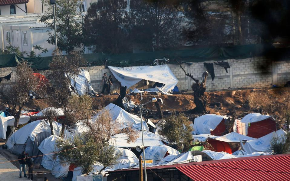 Greek PM expresses shock at refugee deaths in camp blaze