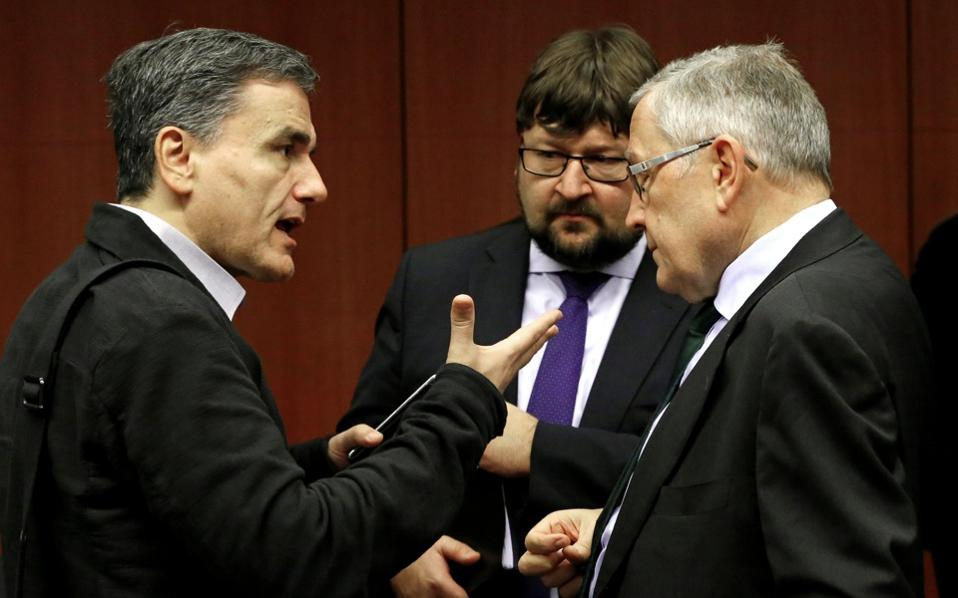 Greece's Finance Minister Euclid Tsakalotos (L) and European Stability Mechanism Managing Director Klaus Regling attend a Eurozone finance ministers meeting in Brussels.