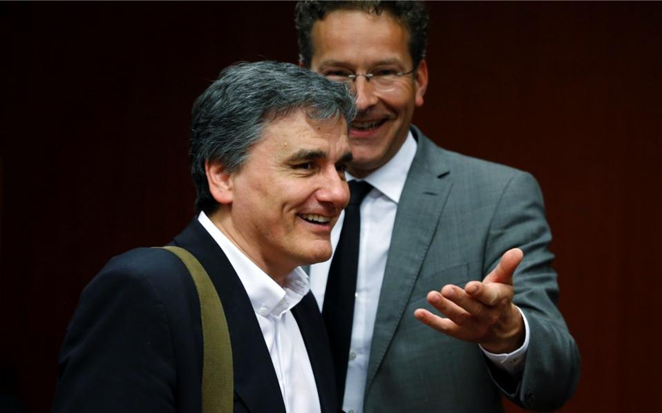 Greek Finance Minister Euclid Tsakalotos and Dutch Finance Minister and Eurogroup President Jeroen Dijsselbloem (r) attend an extraordinary meeting of eurozone finance ministers on Greece at the European Council in Brussels, May 9. [Francois Lenoir/Reuters]