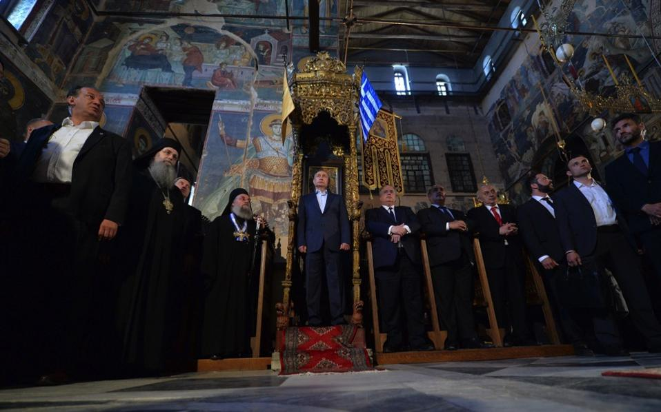 Russian President Vladimir Putin (c) visits the Church of the Protaton, dedicated to the Dormition of the Virgin Mary, in Karyes, the administrative center of the all-male Orthodox monastic community of Mount Athos, northern Greece, May 28. [Alexey Druzhinyn/EPA]