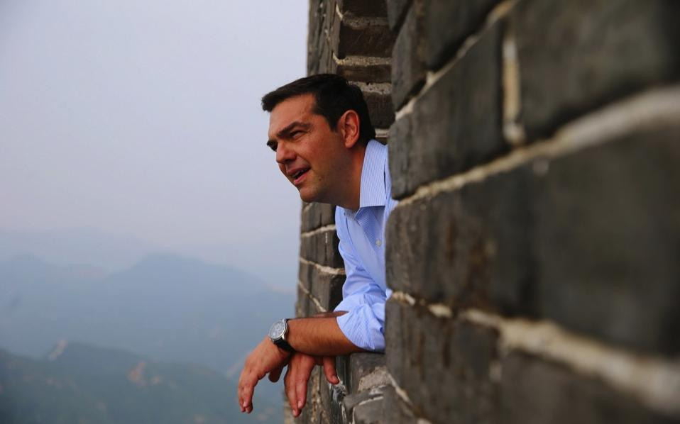 Greek Prime Minister Alexis Tsipras visits the Great Wall at Badaling in Beijing, China, July 3. During his official visit, aimed at boosting bilateral ties, Tsipras met with Chinese Premier Li Keqiang and other officials. [Wu Hong/EPA]