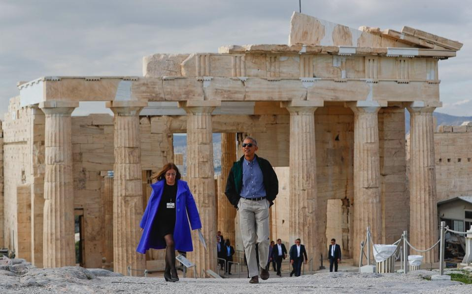 US President Barack Obama tours the Acropolis with Dr Eleni Banou (l) director of the Athens Ephorate of Antiquities, Ministry of Culture, November 16. Obama offered solidarity with Greece over its debt and migrant crises during his final trip to Europe as American president before handing over power to Donald Trump. [Pablo Martinez Monsivais/AP]