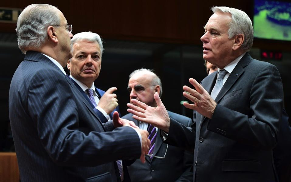 France's Foreign Minister Jean-Marc Ayrault (r), Belgium's Foreign Minister Didier Reynders (2nd l) and Cyprus' Foreign Minister Loannis Kasoulides (l) attend a EU foreign affairs council at the European Council in Brussels, on Monday.