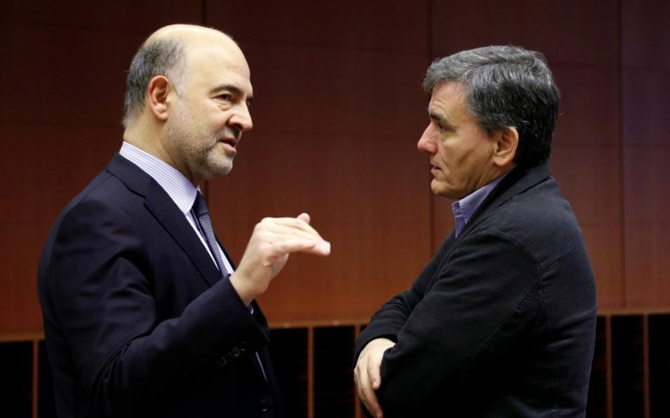 EU Economy Commissioner Pierre Moscovici, left, and Greek Finance Minister Euclid Tsakalotos in Brussels on Monday.