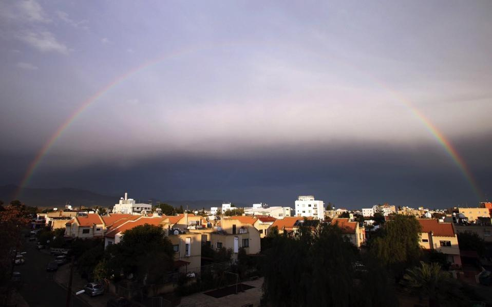 A rainbow spans over Nicosia, Thursday, during a stormy weather which is forecasted across the island.