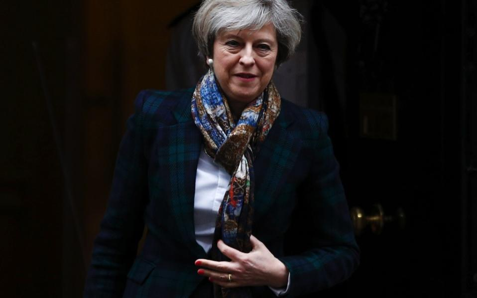 British Prime Minister Theresa May leaves 10 Downing Street in London, Tuesday.