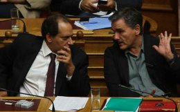 Finance Minister Euclid Tsakalotos (right) will host a meeting with Infrastructure Minister Christos Spirtzis (left) to ratify the AIA deal.