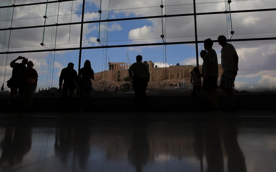 Visitors at the Acropolis Museum in Athens, overlooking the ancient citadel. Other than the usual obstacle of Greek bureaucracy, the process of getting the museum built included a lengthy judicial battle that is fairly typical of the kind of thing that goes on behind the scenes during any major project in this country.
