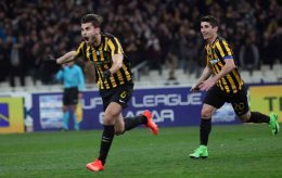 Astrit Ajdarevic (l) celebrates with goal that decided the AEK vs Olympiakos derby on Sunday.