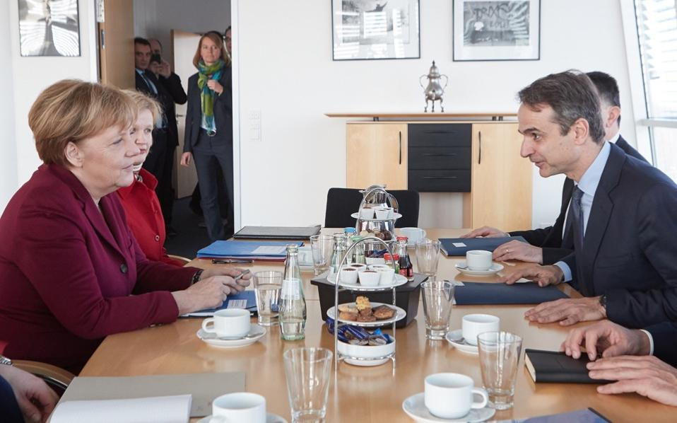ND leader Kyriakos Mitsotakis met German Chancellor Angela Merkel in Berlin on Monday