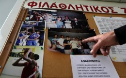 Takis Zivas, coach of Filathlitikos, shows photos when Giannis Antetokounmpo played for this Athenian local team, in Athens. From a scrawny, literally hungry kid kicking a ball around in an open field in the Athens neighborhood of Sepolia to a starter in the NBA All-Star Game, Antetonkoumpo has come a very long way.