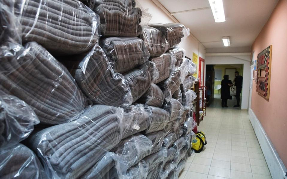 A pile of blankets is stored at a tiny coat workshop charity called Naomi in the northern Greek city of Thessaloniki, which is working long hours to collect and wash discarded blankets and turn them into wearable coats.