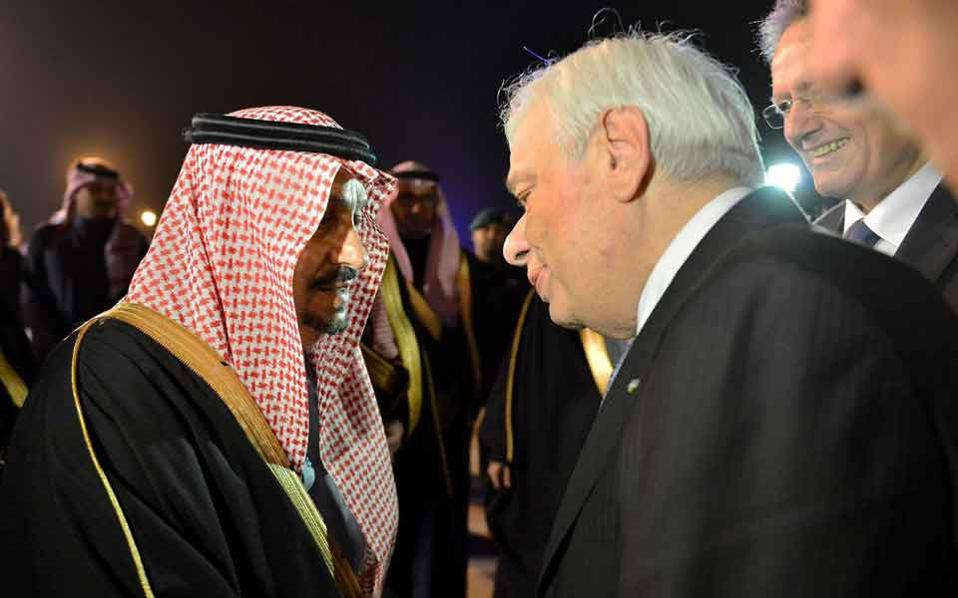 Prince Faisal bin Bandar al-Saud (left), the governor of Riyadh, shakes hands with Greek President Prokopis Pavlopoulos (right) in the Saudi capital on Monday.