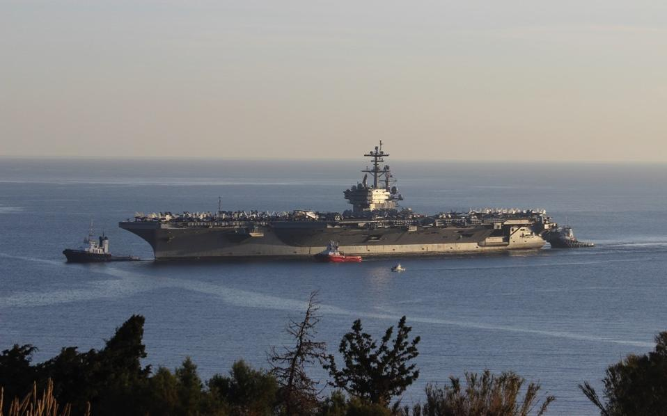 The aircraft carrier USS George H. W. Bush at Souda Bay, in Crete. The American presence in Souda has hit a new record over the past year, with dozens of military units having tied up at Marathi as the base there becomes increasingly important to allied activities in the broader region.