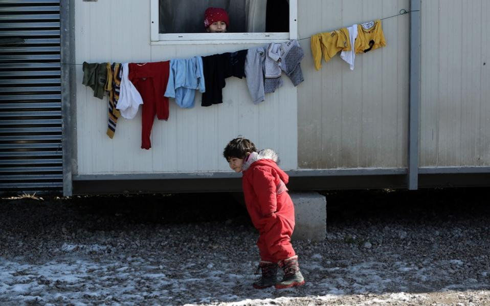 A child plays at the Elaionas refugee camp in Athens, in a January photo.