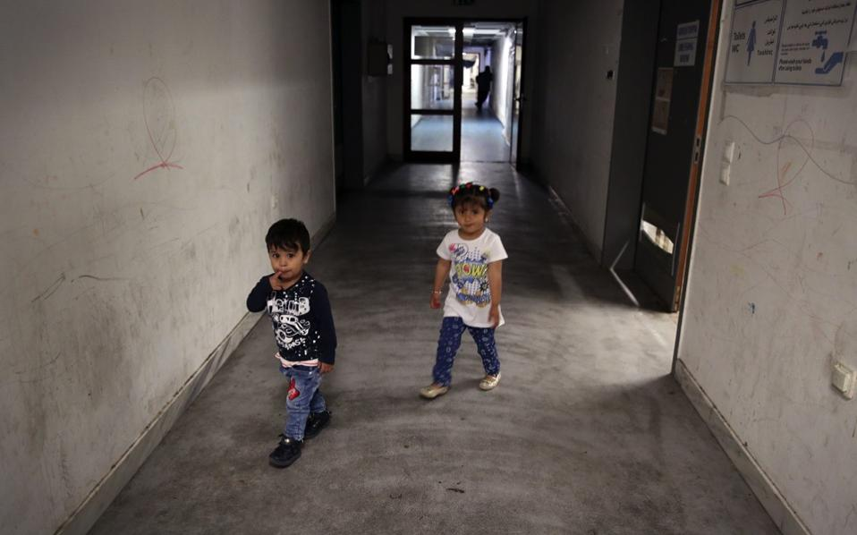 Children walk in a corridor, inside the facilities of the refugee camp in the former hockey Olympic Complex in Athens, earlier this week.