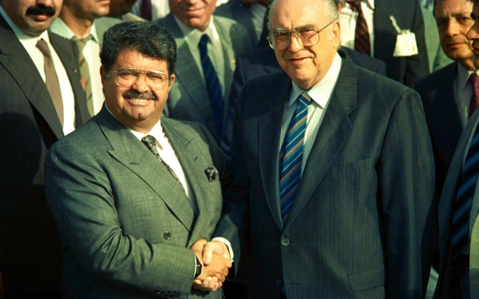 Greece's late prime minister Andreas Papandreou (right) and his Turkish counterpart Turgut Ozal pictured at the now defunct airport in Elliniko after their three-day meeting in Athens in the summer of 1998. It was the first visit in Greece by a Turkish premier in 36 years.