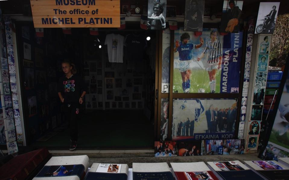 A woman walks by the memorabilia in a museum dedicated to UEFA president Michel Platini, the French former soccer great, owned by Philippos Stavrou Platini, in Mosfiloti, Cyprus.