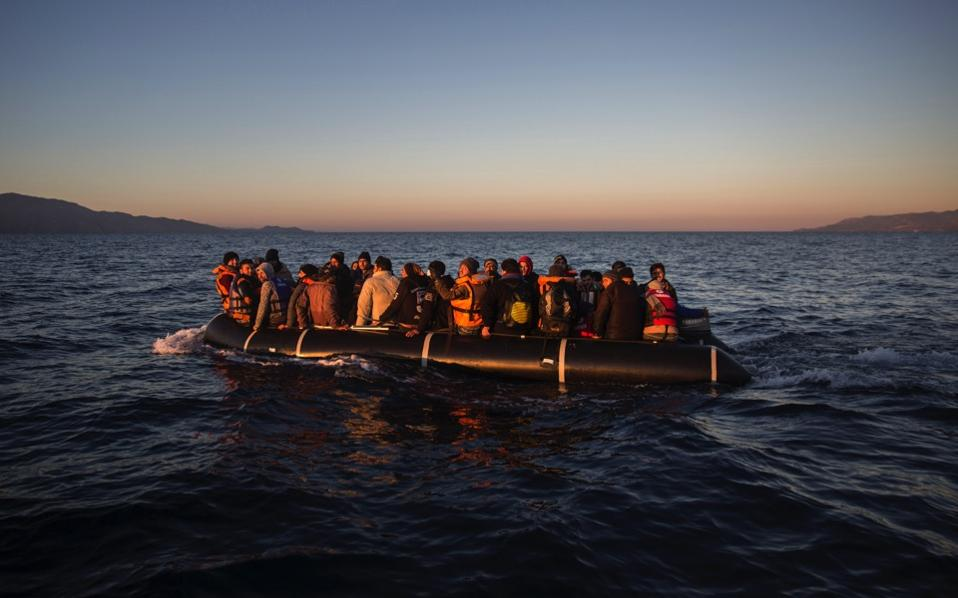 Refugees and migrants onboard a dinghy approach the Greek island of Lesvos on their way from the Turkish coast, in this file photo. The EU-Turkey deal arguably got more credit than it was due for slowing the flow of refugees to Greece, but the agreement certainly played a part, argues Megan Greene.