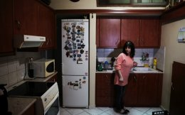 Eleni Skopelitis in her kitchen in the suburb of Nikaia, in Athens. The Skopelitis family house is up for auction in September as they cannot longer pay their monthly loan obligations.