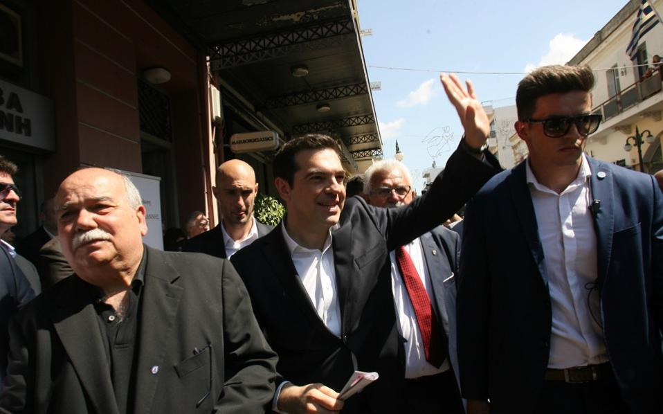 Prime Minister Alexis Tsipras waves to supporters in Amaliada in the Peloponnese during a trip to attend a museum opening, on Monday.