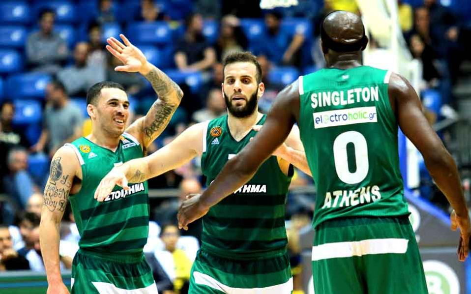 Mike James, Nikos Pappas and Chris Singleton celebrate in Israel.