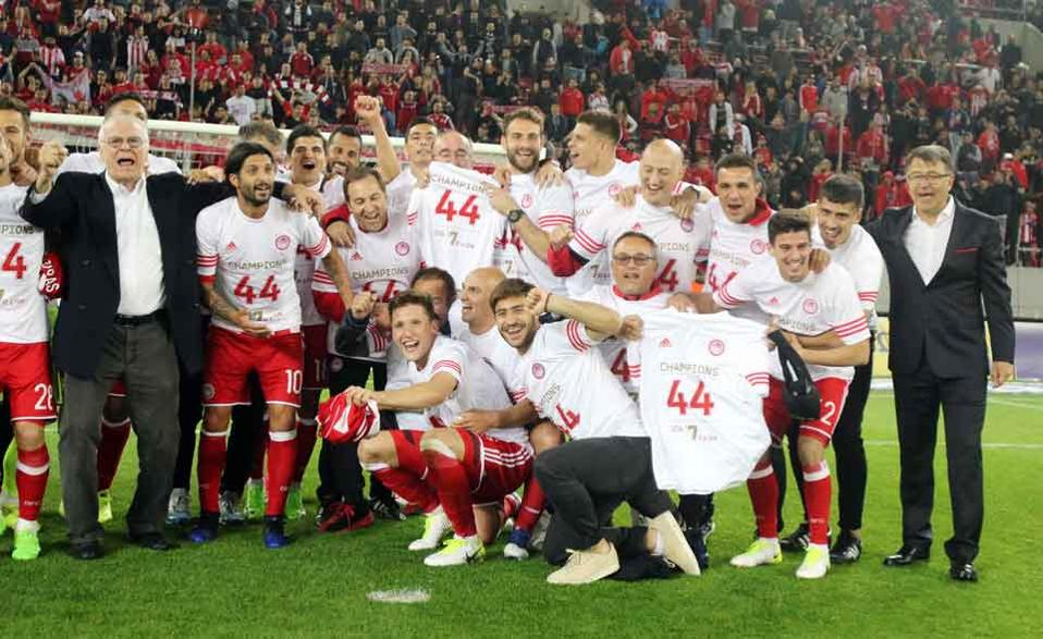 Olympiakos celebrated its 44th league title on Sunday, pending a court decision.