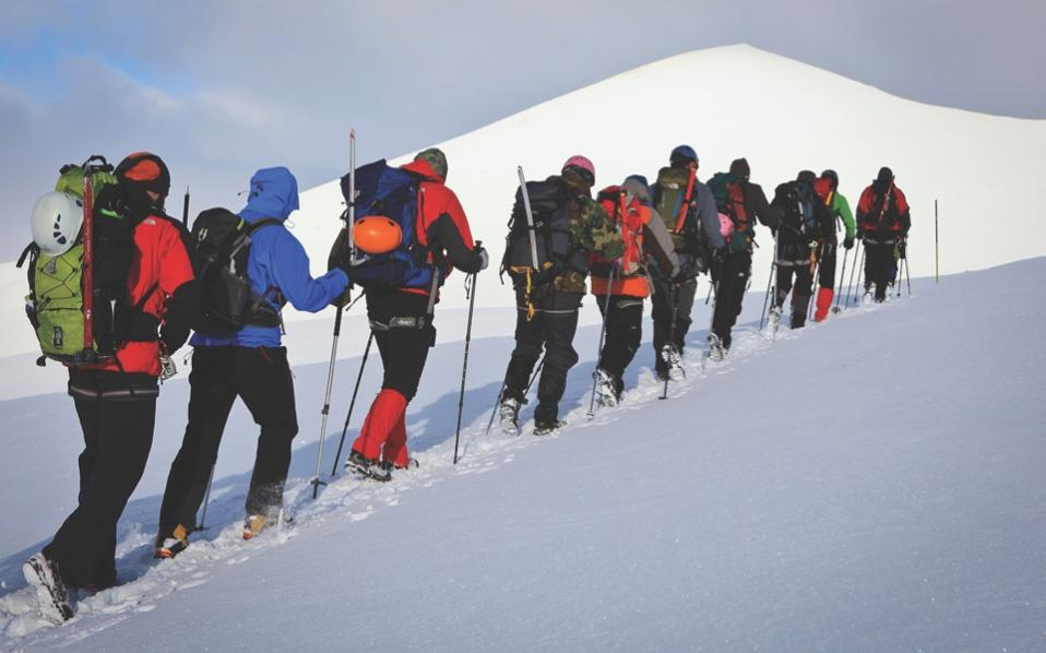 A group from the mountaineering school is taken on a winter expedition by an expert guide. [Babis Giritziotis]