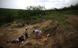 A team of scientists, led by Professor Nikolai Spassov, works near the site where an isolated tooth of Graecopithecus freybergi was found in 2009, near the town of Chirpan, Bulgaria, June 3.
