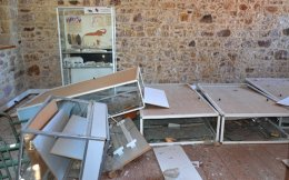 Damages of exhibits are seen at the Museum of Paleontology and Geology inside a historic building from the 19th century, in the village of Vrisa, Lesvos island, Thursday.