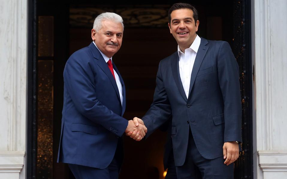 Greek, Turkish leaders meet amid tension over servicemen