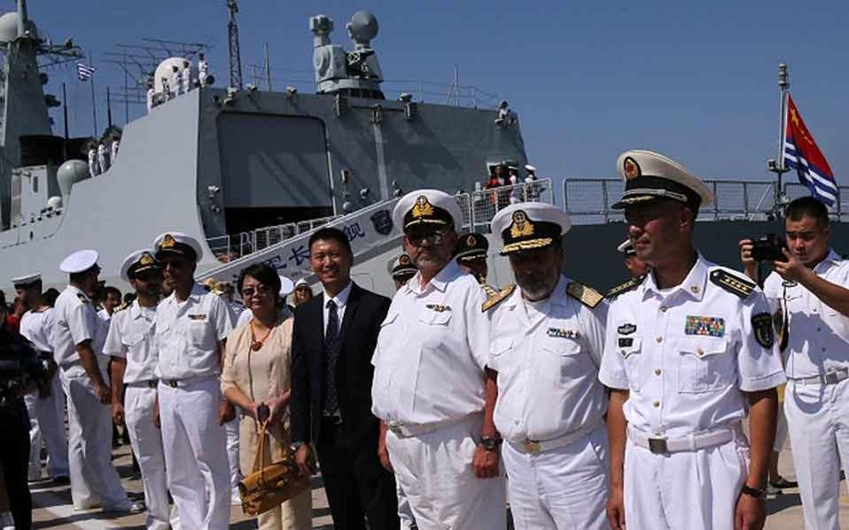 A welcome ceremony is held for the visiting Chinese naval fleet at Piraeus port. (Xinhua/Marios Lolos)