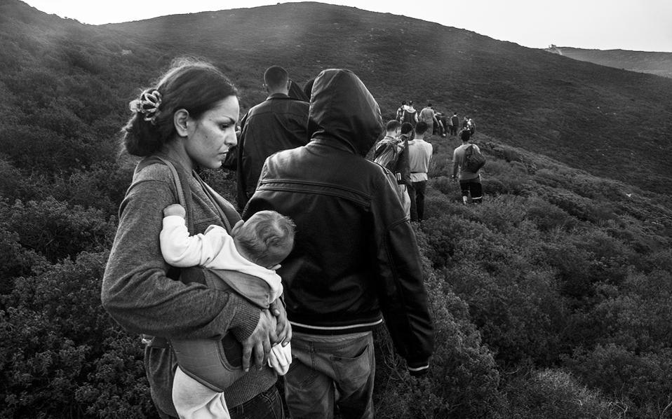 A Syrian mother holds her 4-month-old baby on the island of Oinousses.