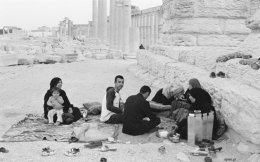 A family picnic among the ruins of Palmyra and a man going about his business in Aleppo are scenes that have been extinguished by war in Syria.