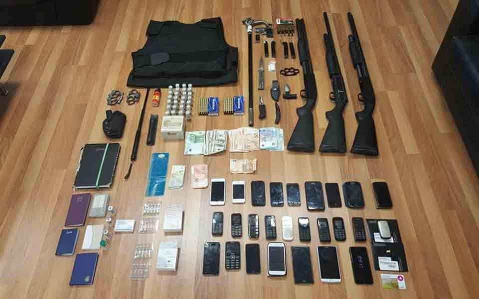 Police handout photo of evidence found during raids on racket members.