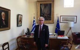 The chairman of the Olympia and Bequests Committee's board, which administers the Zappeion Hall, Giorgos Christou. A portrait of Evangelos Zappas is seen at left.