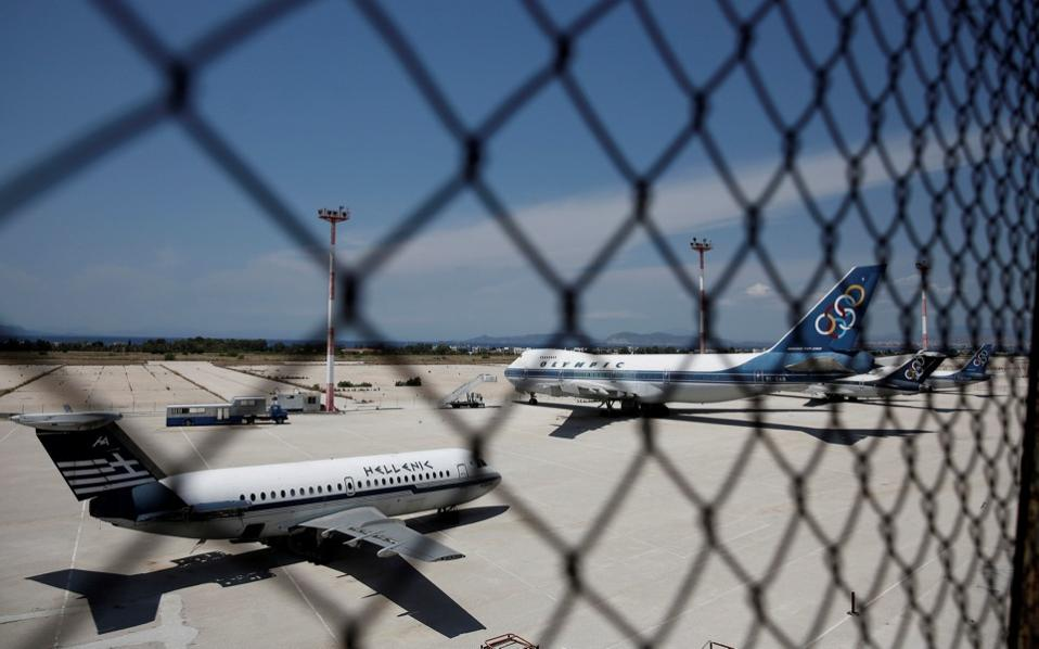 Scrapped aircrafts are seen at the tarmac of the former international Hellenikon airport in Athens, Greece, July 16, 2017 [Costas Baltas/Reuters]