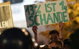 People hold a placard '13 percent is a shame' during a protest against the Alternative for Germany (AfD) party in Berlin, on Sunday.