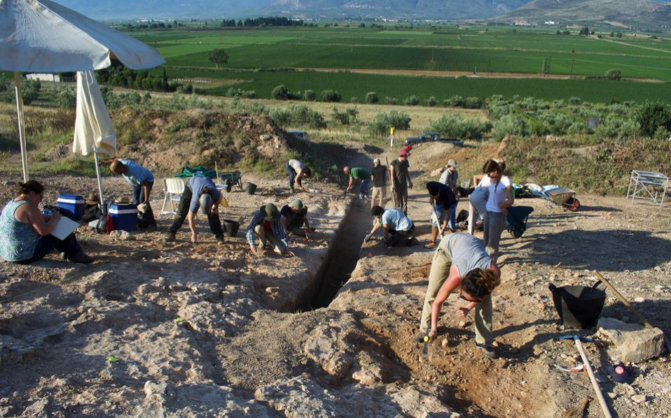 A handout photo made available by the Greek Ministry of Culture released shows archaeologists working at the site where one of the largest Mycenaean-era carved tombs ever found in Greece has been discovered, in Orchomenos, Viotia, central Greece.