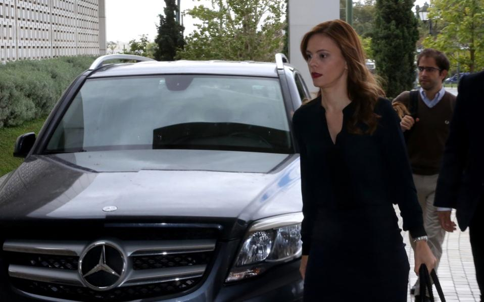 Labor Minister Efi Achtsioglou arrives at an Athens hotel for a meeting with bailout monitors.