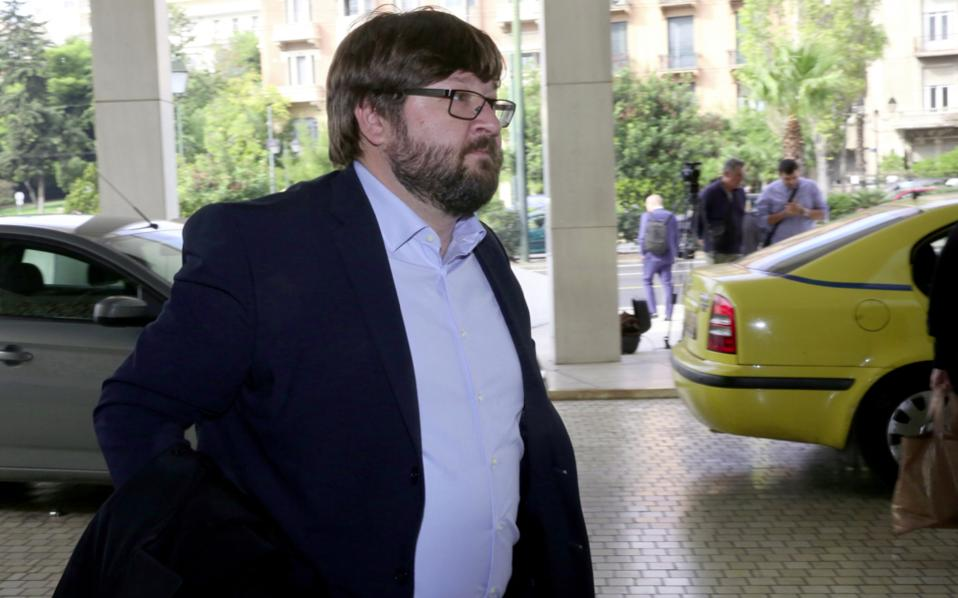 ESM's Nicola Giammarioli arrives for the meeting with Alternate Finance Minister Giorgos Houliarakis and other Greek officials.